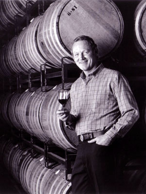 Peterson poses in front of barrels on Peterson Pallets in 1981 at The Monterey Vineyard.